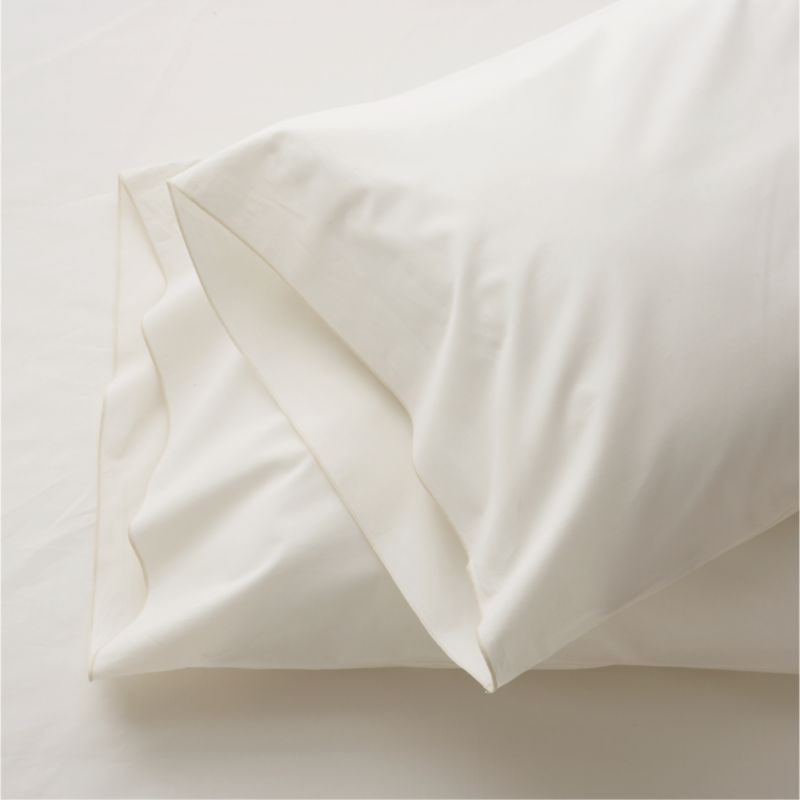 Clean, basic white bedding upgrade in soft, smooth cotton percale, beautifully contrasted with a graceful ivory overlocking stitch. Bed pillows also available.<br /><br /><NEWTAG/><ul><li>100% cotton percale</li><li>200-thread-count</li><li>Machine wash; tumble dry low</li><li>Made in Portugal</li></ul>
