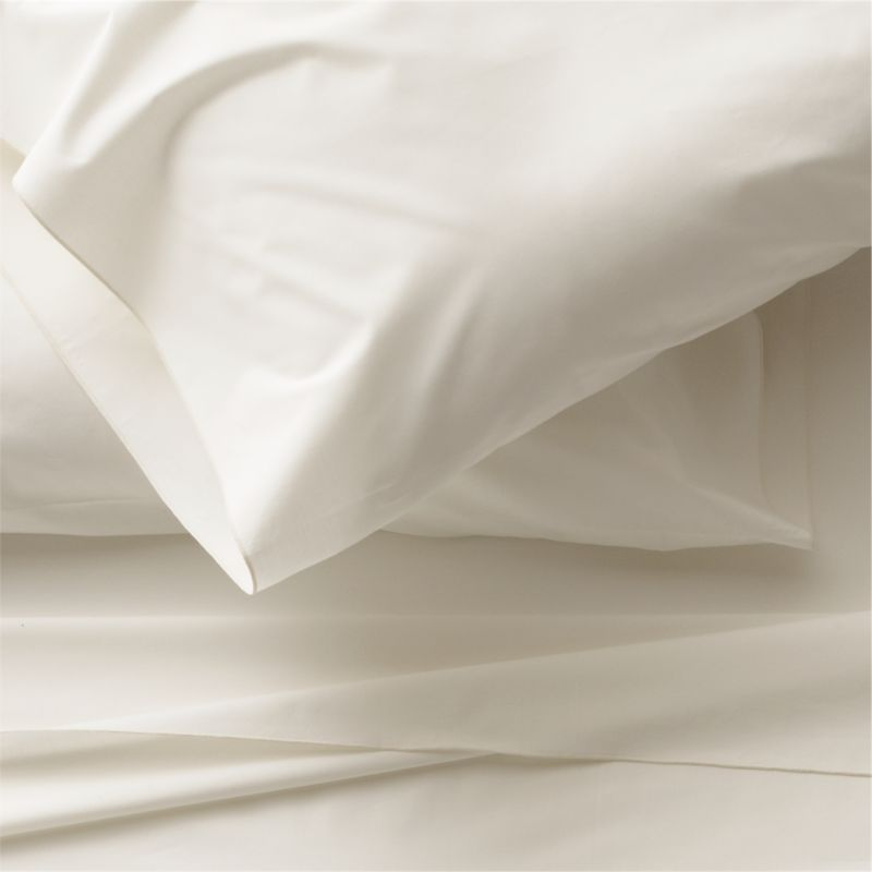 Clean, basic white bedding upgrades in soft, smooth cotton percale, beautifully contrasted with a graceful ivory overlocking stitch on the flat sheet and pillow case. Generous fitted sheet pockets accommodate thicker mattresses. Sheet set includes one flat sheet, one fitted sheet and two standard pillow cases. Bed pillows also available.<br /><br />This product is certified by Oeko-Tex®, an international association focused on textile safety and sustainable production. Oeko-Tex® tests for known harmful substances and chemicals as well as for acidity and color fastness. All components of the product must comply with stringent Oeko-Tex® standards to achieve certification.<br /><br /><NEWTAG/><ul><li>Certified by Oeko-Tex</li><li>100% cotton percale</li><li>200-thread-count</li><li>Machine wash; tumble dry low</li><li>Made in Portugal</li></ul>