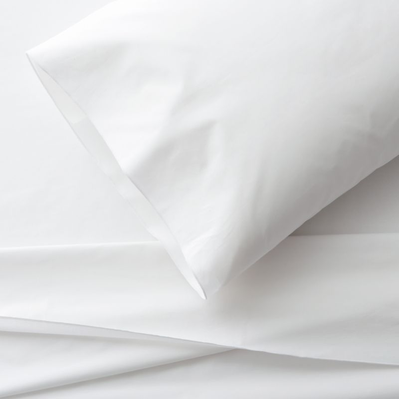 Clean, basic white bedding upgrades in soft, smooth cotton percale, beautifully accented with a graceful overlocking embroidery stitch on the flat sheet and pillow case. Generous fitted sheet pockets accommodate thicker mattresses. Sheet set includes one flat sheet, one fitted sheet and one standard pillow case. Bed pillows also available.<br /><br />This product is certified by Oeko-Tex®, an international association focused on textile safety and sustainable production. Oeko-Tex® tests for known harmful substances and chemicals as well as for acidity and color fastness. All components of the product must comply with stringent Oeko-Tex® standards to achieve certification.<br /><br /><NEWTAG/><ul><li>Certified by Oeko-Tex</li><li>100% cotton percale</li><li>200-thread-count</li><li>Machine wash; tumble dry low</li><li>Made in Portugal</li></ul>