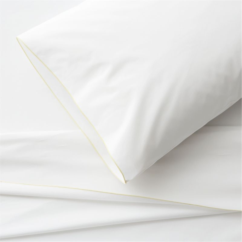 Clean, basic white bedding upgrades in soft, smooth cotton percale, beautifully contrasted with a graceful yellow overlocking stitch on the flat sheet and pillowcase. Generous fitted sheet pockets accommodate thicker mattresses. Sheet set includes one flat sheet, one fitted sheet and one standard pillowcase. Bed pillows also available.<br /><br /><NEWTAG/><ul><li>100% cotton percale</li><li>200-thread-count</li><li>Machine wash; tumble dry low</li><li>Made in Portugal</li></ul>