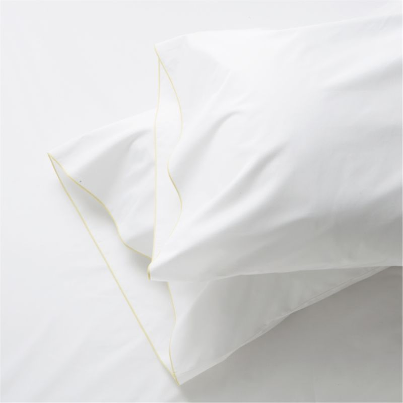 Clean, basic white bedding upgrade in soft, smooth cotton percale, beautifully contrasted with a graceful yellow overlocking stitch. Bed pillows also available.<br /><br /><NEWTAG/><ul><li>100% cotton percale</li><li>200-thread-count</li><li>Machine wash; tumble dry low</li><li>Made in Portugal</li></ul>