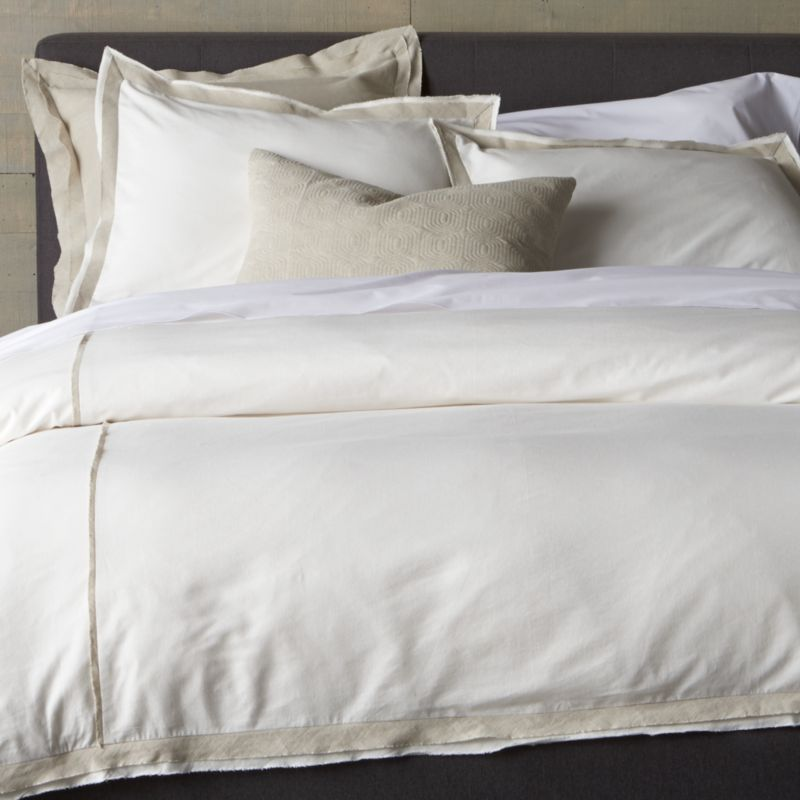 Linen and cotton seam up as neutral naturals with a modern edge. Duvet cover stitches up white panels with a natural colored fabric at the seam and along the edge, frayed for a casual, artisanal feel. Cover reverses to solid white and includes a hidden button closure and interior fabric ties to secure the duvet. Duvet insert also available.<br /><br /><NEWTAG/><ul><li>Base fabric is 88% Cotton and 12% Linen</li><li>Decorative fabric is 52% linen and 48% cotton</li><li>Hidden button closure</li><li>Interior fabric ties</li><li>Machine wash cold, tumble dry low</li><li>Professional Dry Cleaning recommended for best results</li><li>Made in India</li></ul>