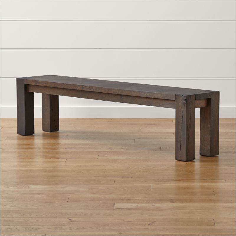 """Big Sur brings big, bold seating to dining rooms and great rooms. All about the sheer raw beauty of nature, the Big Sur 71.5"""" bench is crafted of solid European white oak, with legs from a single piece of heartwood (the strongest part of the tree) exposing the trunk's inner rings. <NEWTAG/><ul><li>Solid European white oak with charcoal stain and tinted wax finish</li><li>Peg detailing</li><li>Heartwood legs</li><li>Seats 3</li><li>Made in Poland</li></ul>"""