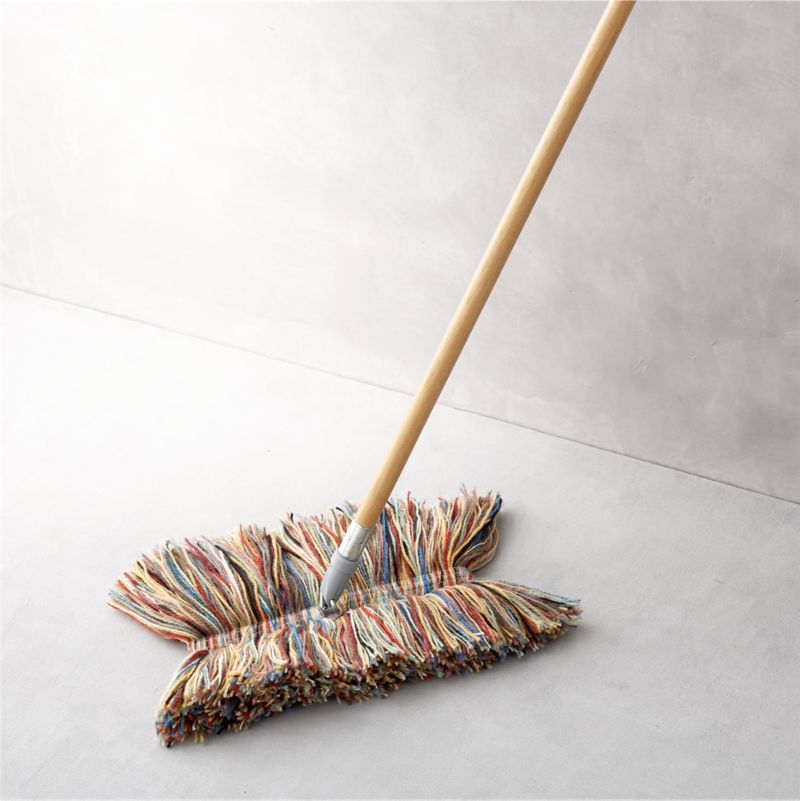 Dust doesn't stand a chance with this pure wool mop handcrafted in Vermont. The natural properties of lanolin draw and hold dust until you're ready to give the mop a good shake. Each removable mop head is a unique combination of multicolored wool fibers and is securely affixed to a sturdy poplar wood pole with fabric tab fasteners. Convenient swivel head adds easy maneuverability and reaches tight spots. Best of all, wool has twice the life expectancy of cotton mops.<br /><br /><NEWTAG/><ul><li>Pure wool mop head</li><li>Poplar wood handle</li><li>Head attaches to pole with fabric tab fasteners</li><li>Hand wash the removable wool head</li><li>Made in USA</li></ul>