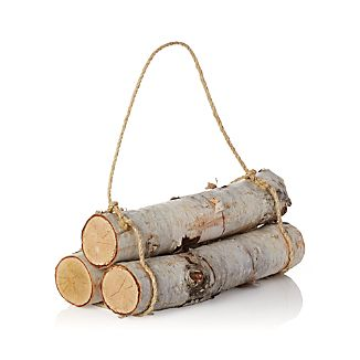 Trio of slender birch logs lends a rustic, woodsy touch to the hearth or porch. Natural jute cord keeps logs tidy and loops to form a carrying handle.This item is not available for shipping to Florida.