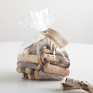 Small logs of natural birch fit in a centerpiece bowl or scatter on the winter table for a rustic, organic tablescape. Although the logs are meant as a nature-inspired decoration, they are untreated and may also be burned.This item is not available for shipping to Florida.