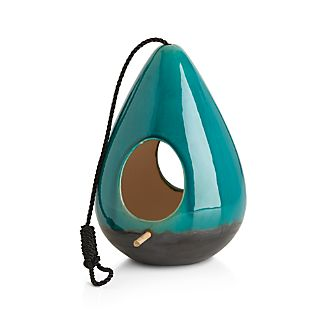 This modern, sculptural terra cotta bird feeder has gorgeous, high-gloss glazing in emerald and brown to attract flying friends.