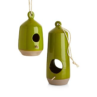 This modern, sculptural terra cotta bird feeder with gorgeous, high-gloss glazing in bright and sandy brown is sure to attract flying friends.Glazed terra cottaHanging ropeDo not leave outdoors during harsh weather conditionsHand washMade in Portugal