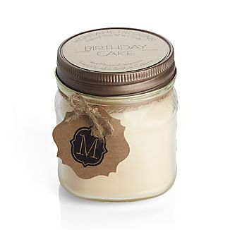 Decorated with rainbow sprinkles, this handcrafted soy wax candle not only looks like a birthday cake, it also wafts the luscious scent of frosting and cake when lit. Each candle is handpoured into a glass jar with lid.