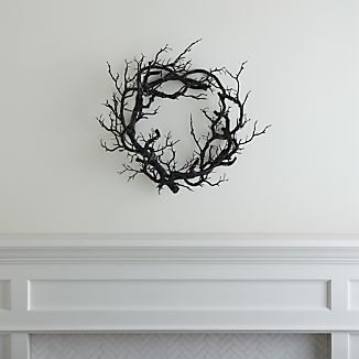 Bereft of leaves and dyed black, realistically detailed branches entwine in a creepy Halloween wreath.