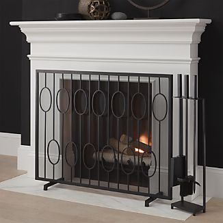 Updating a vintage staircase design, this handcrafted iron fireplace screen adds a modern, graphic touch to the room.
