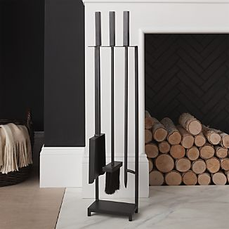 Clean, geometric lines lend a mid-century look to Ana Reza-Hadden's smart design for modern fireplace tools. Iron stand and tools—brush, shovel and poker--are handmade in India.