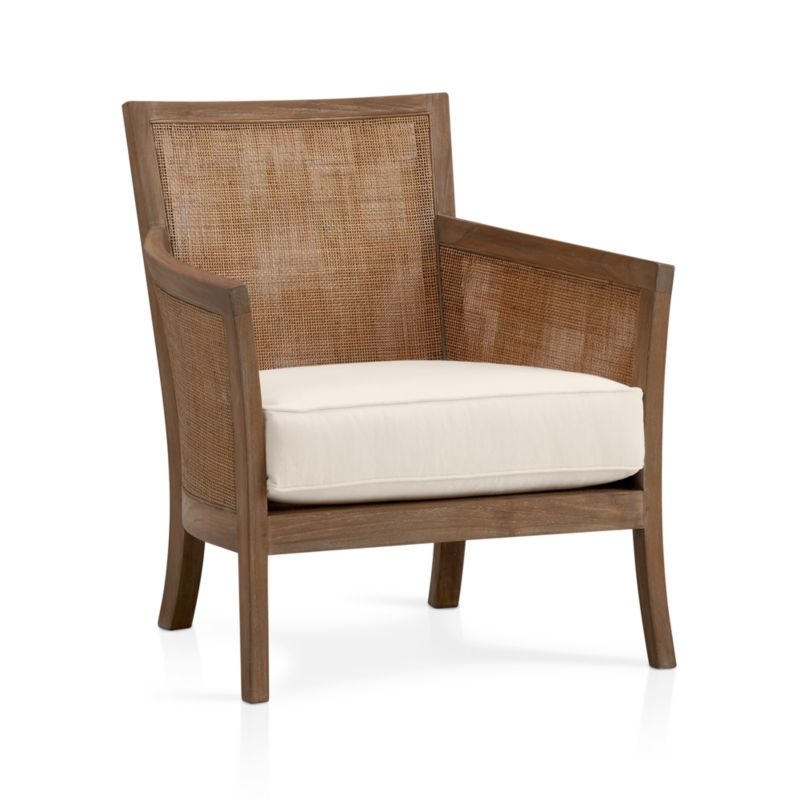 "We've freshened up our popular solid teak and handwoven rattan lounge seating with a soft grey wash and white cotton-poly cushions. And, more importantly, we've given it an eco-friendly upgrade: The frame is crafted of plantation-grown teak supported by TFT, a nonprofit organization that promotes responsible forest management, and the 5""-thick cushioning is multilayer soy- or plant-based polyfoam. Strong webbed suspension supports the woven rattan seat. A great chair in pairs. Also stocked in espresso finish with leather cushion.<br /><br /><NEWTAG/><ul><li>Solid teak harvested from plantations working with TFT and woven rattan mesh</li><li>Grey wash finish</li><li>Nylon webbing suspension</li><li>Cotton-polyester cushion with multilayer soy- or plant-based polyfoam</li><li>Professional cushion cleaning recommended</li><li>Made in Indonesia and USA of domestic and imported materials</li></ul>"