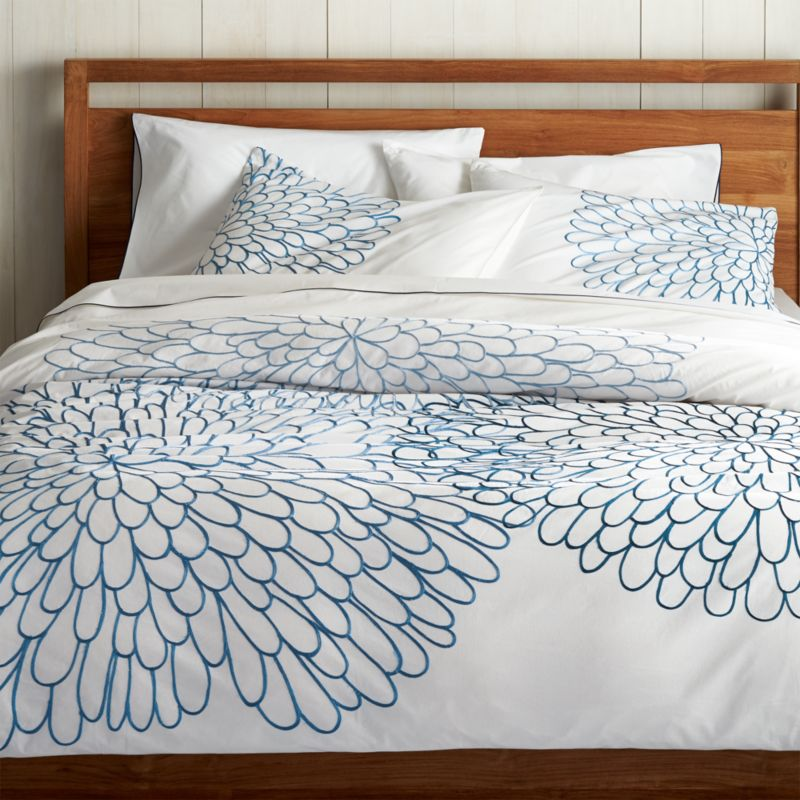 Full-blossom blooms in tonal blues embroider large clusters of graphic petals on crisp white cotton for a fresh bedding pattern that's perfect for spring. Linens reverse to solid white. Duvet has hidden button closure and interior fabric ties to keep insert in place. Duvet insert also available.<br /><br /><NEWTAG/><ul><li>100% cotton percale</li><li>180-thread-count</li><li>100% rayon embroidery</li><li>Hidden button closure and interior fabric ties</li><li>Machine wash cold, tumble dry low; warm iron as needed</li><li>Made in India</li></ul>