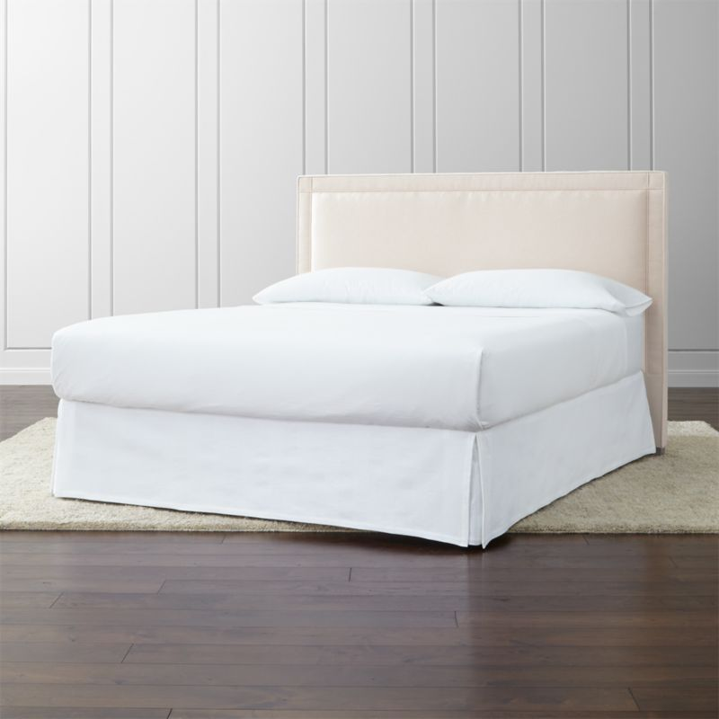 The Border California king headboard takes the edge off with its square sensibility and linear silhouette, wrapped in a soft neutral cotton-poly blend. Outlining the edges of this headboard with horizontal and vertical lines intersecting at each corner, self-welt detailing adds architectural polish. The Border California King Headboard is a Crate and Barrel exclusive.<br /><br /><NEWTAG/><ul><li>Frame is benchmade with certified sustainable hardwood that's kiln-dried to prevent warping</li><li>Soy-based polyfoam cushioning</li><li>Solid maple legs with brown finish</li><li>Headboard requires a bed frame (sold separately)</li><li>When attached to Crate and Barrel bed frame no additional hardware required; accommodates mattress and box spring (sold separately)</li><li>Non-Crate and Barrel bed frame may require a Modi-Plate Kit (sold separately)</li><li>Material origin: see swatch</li><li>Made in North Carolina, USA</li></ul>