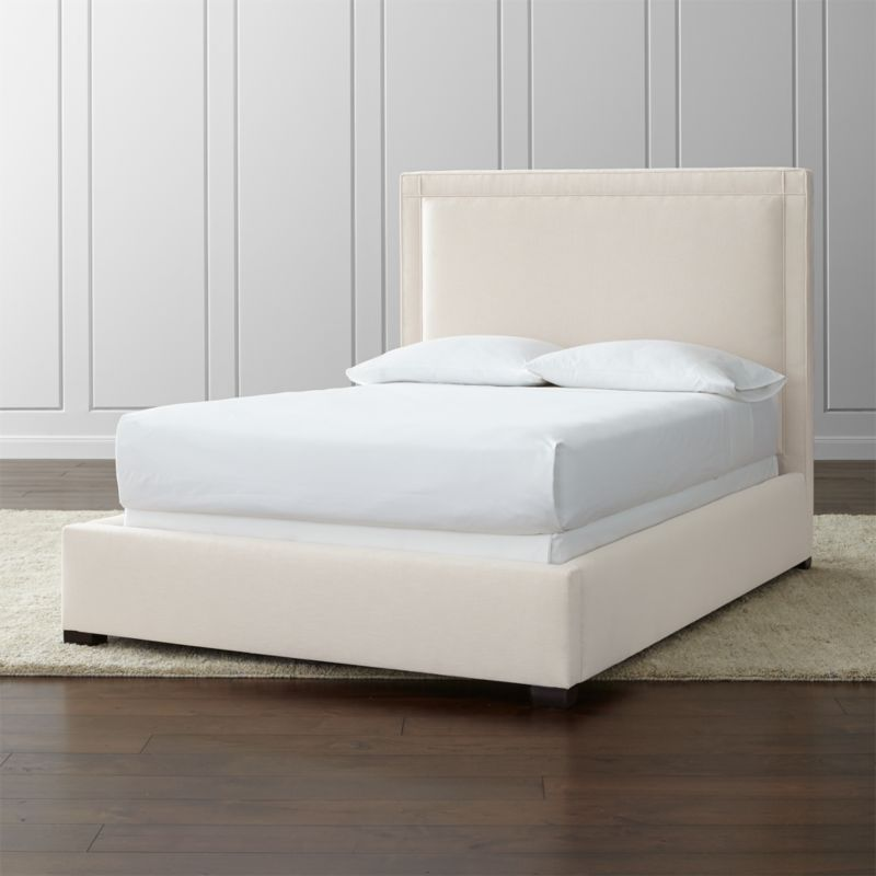 "With its square sensibility and linear frame, our Border full bed takes the edge off in a soft, neutral cotton-poly blend. Adding architectural polish, self-welt detail outlines the perimeter of the full bed with horizontal and vertical lines intersecting at each corner. <NEWTAG/><ul><li>Frame is benchmade with certified sustainable hardwood that's kiln-dried to prevent warping</li><li>Soy-based polyfoam cushioning</li><li>Solid maple legs with brown finish</li><li>3 metal slats with 3 center support legs</li><li>Accommodates <a href=""/furniture/mattresses-foundations/1"">mattress and box spring</a> (sold separately)</li><li>Maximum weight capacity: 800 lbs. (includes weight of mattress, box spring and occupants)</li><li>Made in North Carolina, USA of domestic and imported materials</li></ul><br />"
