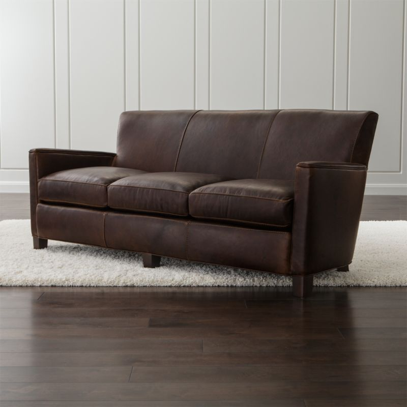 Architectural lines meet rich vintage-inspired leather in this distinctive nod to Art Deco. Leather club chair comfort is top-of-the-line with an eight-way, hand-tied suspension system and 3 seat cushions that provide a luxurious sink-in experience for 3. <NEWTAG/><ul><li>Frame is benchmade with certified sustainable hardwood that's kiln dried to prevent warping</li><li>Soy-based polyfoam with fiber back cushion encased in synthetic ticking</li><li>Eight-way, hand-tied suspension</li><li>Hardwood legs with black walnut stain</li><li>Material origin: see swatch</li><li>Made in North Carolina, USA</li></ul><br />