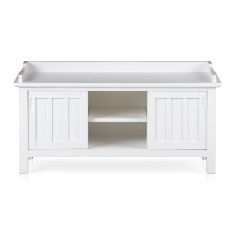 We've modernized classic cottage styling without sacrificing an ounce of charm. Linear, multipurpose bench is crafted with traditional board and batten detailing and dressed in bright white lacquer. Two doors slide open to reveal one adjustable shelf each, plus one in the center.<br /><br /><NEWTAG/><ul><li>Solid poplar and engineered wood</li><li>White lacquer finish</li><li>Three adjustable shelves</li><li>Made in Vietnam</li></ul>
