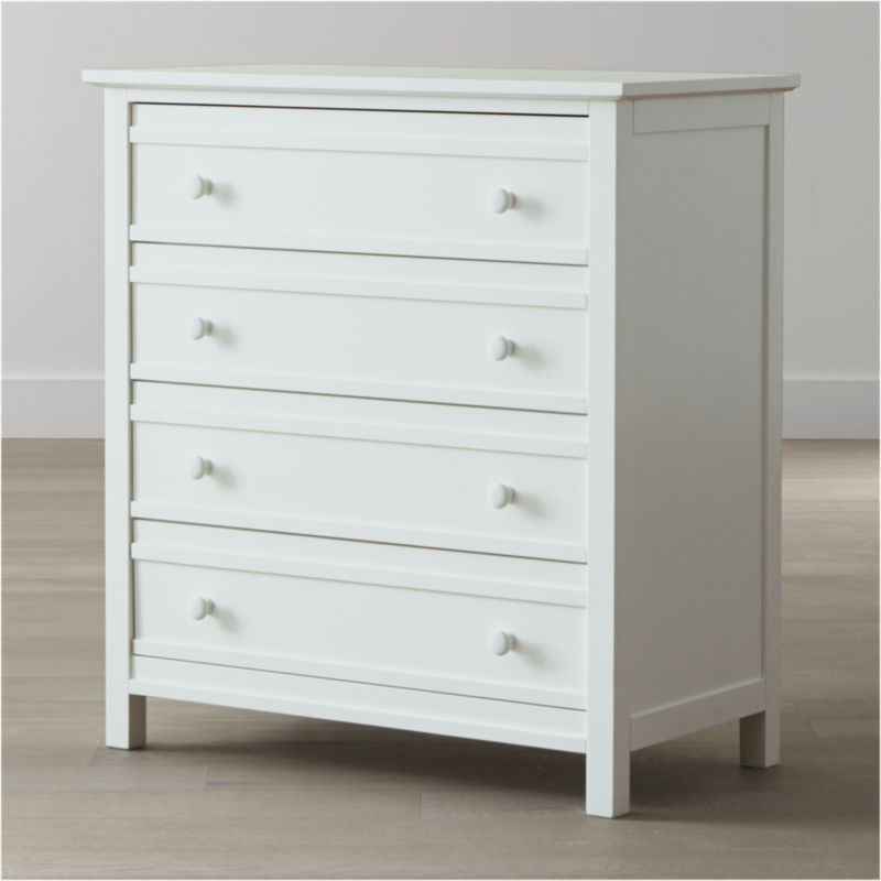 Updated bedroom storage in fresh white, inspired by traditional cottage architecture. This classic Crate and Barrel collection includes our 4-drawer chest, with stepped drawer detailing and recessed panel sides echoing the board-and-batten aesthetic of our Brighton beds. <NEWTAG/><ul><li>Designed by Blake Tovin of Tovin Design</li><li>Solid poplar and engineered wood with white lacquer finish</li><li>Naturally expands and contracts with changes in humidity</li><li>4 drawers</li><li>Metal side-mounted glides</li><li>White porcelain knobs</li><li>Made in Vietnam</li></ul>