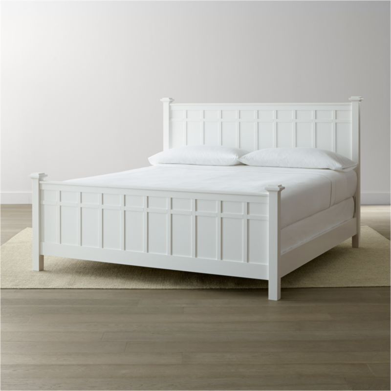 In an update on classic 19th century cottage styling, our Brighton king bed offers a clean, contemporary silhouette with squared-off headboard, footboard, posts and finials. The crisp white finish and architectural board and batten detailing lend a distinctive touch to the traditional design. <NEWTAG/><ul><li>Designed by Blake Tovin of Tovin Design</li><li>Solid poplar and engineered wood with white lacquer finish</li><li>Naturally expands and contracts with changes in humidity</li><li>13 slats and 3 support legs</li><li>Adjustable for mattress and box spring or mattress only for under-bed storage</li><li>Mattresses and box springs also available (sold separately)</li><li>Maximum weight capacity: 800 pounds (includes weight of mattress, optional box spring and occupants)</li><li>Made in Vietnam</li></ul>
