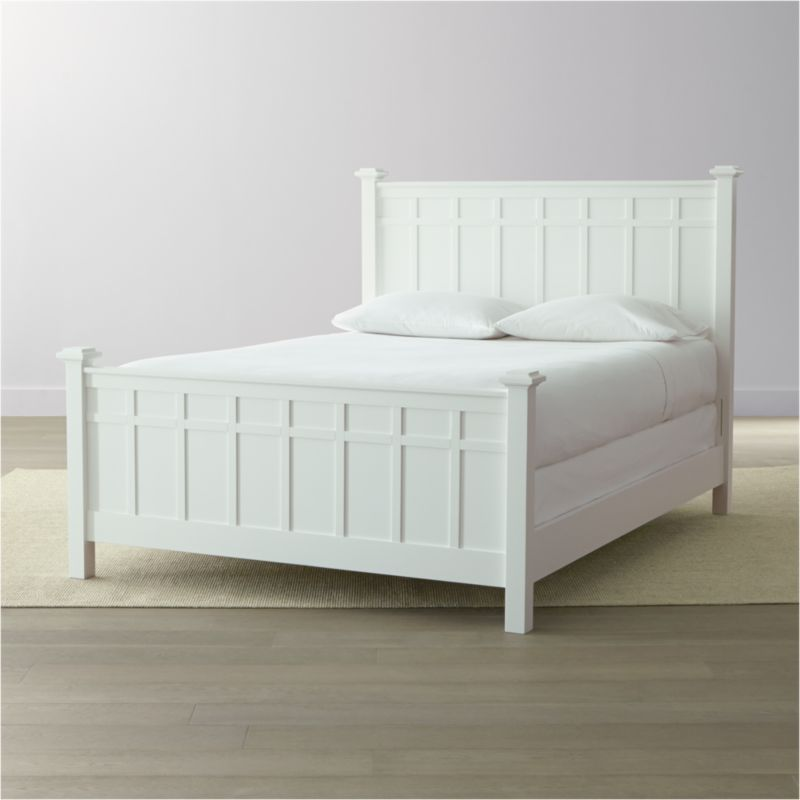 Brighton modernizes traditional cottage styling in crisp white. A Crate and Barrel classic, this queen bed's headboard, footboard and posts are squared off to create a clean, contemporary silhouette. For versatility, 2 side rail options allow for use with both mattress and box spring, or with a mattress only, leaving room below to allow for under-bed storage. <NEWTAG/><ul><li>Designed by Blake Tovin of Tovin Design</li><li>Solid poplar and engineered wood with white lacquer finish</li><li>Naturally expands and contracts with changes in humidity</li><li>13 slats and 3 support legs</li><li>Adjustable for mattress and box spring or mattress only for under-bed storage</li><li>Mattresses and box springs also available (sold separately)</li><li>Maximum weight capacity: 800 pounds (includes weight of mattress, optional box spring and occupants)</li><li>Made in Vietnam</li></ul>