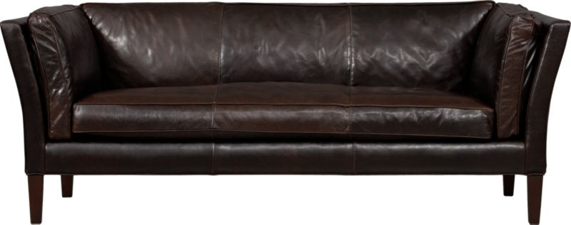 Inspired by a Parisian flea market find, Brooks has the heirloom charm of Old World craftsmanship updated with lean contemporary lines. Luxe full-grain leather is cured deep chocolate with subtle vintage-y marbling that ages beautifully over time. Offering a soft respite, plush cushion is semi-attached to frame, accentuated by self-welt detail. Legs are finished in tobacco.<br /><br />After you place your order, we will send a leather swatch via next day air for your final approval. We will contact you to verify both your receipt and approval of the leather swatch before finalizing your order.<br /><br /><NEWTAG/><ul><li>Eco-friendly construction</li><li>Certified sustainable, kiln-dried hardwood frame</li><li>Cushions and bolsters are soy-based polyfoam and fiber-down blend encased in downproof ticking</li><li>Sinuous wire spring suspension</li><li>Full-grain leather</li><li>Self-welt detail</li><li>Hardwood legs have a tobacco stain</li><li>Benchmade</li><li>See additional frame options below</li><li>Made in North Carolina, USA</li></ul>