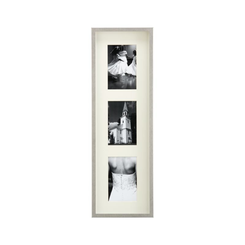 Showcase photos in contemporary brushed stainless steel. Deep shadow box frames a beveled off-white mat, oversized for dramatic effect. Triple frame hangs vertically or horizontally.<br /><br /><NEWTAG/><ul><li>Brushed stainless steel</li><li>Off-white mat</li><li>MDF backboard</li><li>Made in Taiwan</li></ul><br />