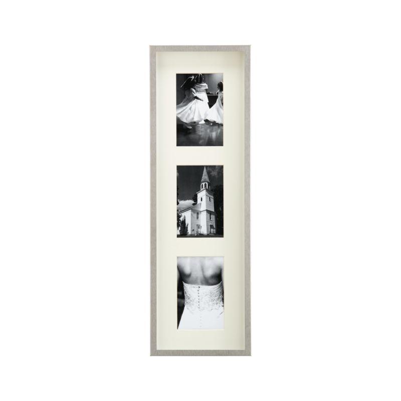 Showcase photos in contemporary brushed stainless steel. Deep shadow box frames a beveled off-white mat, oversized for dramatic effect. Triple frame hangs vertically or horizontally.<br /><br /><NEWTAG/><ul><li>Brushed stainless steel</li><li>Off-white mat</li><li>MDF backboard</li><li>Made in Taiwan</li></ul><br />