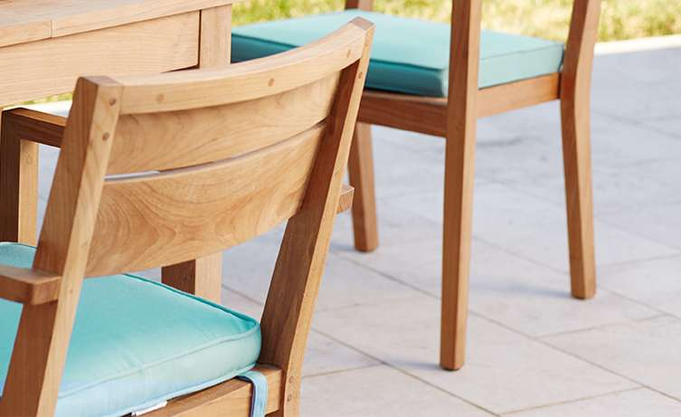 Regatta wood outdoor dining furniture with cushions in Sunbrella fabric in Mineral color