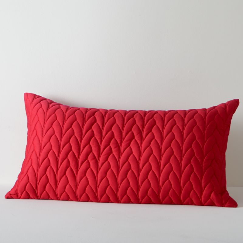 Braided cotton rope design cozies the bed with loads of quilted texture in rosy red that looks festive all by itself or layered with loads of decorative pillows. Sham has overlapping flap closure.<br /><br /><NEWTAG/><ul><li>100% cotton</li><li>Machine wash, tumble dry low</li><li>Made in India</li></ul>