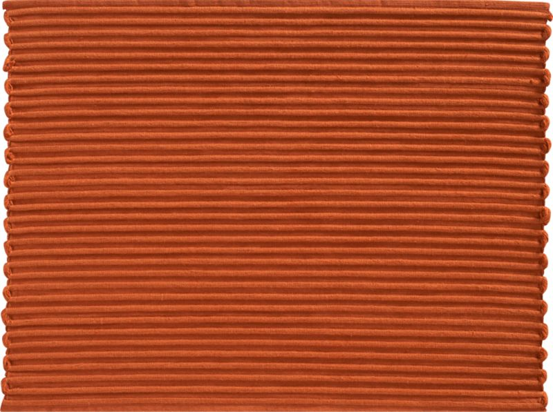 The rustic rib weave of this hand-dyed, hand-woven cotton placemat creates a scalloped edge for a soft, organic effect.<br /><br /><NEWTAG/><ul><li>100% cotton</li><li>Oversized to allow for shrinkage</li><li>Machine wash</li></ul><br />