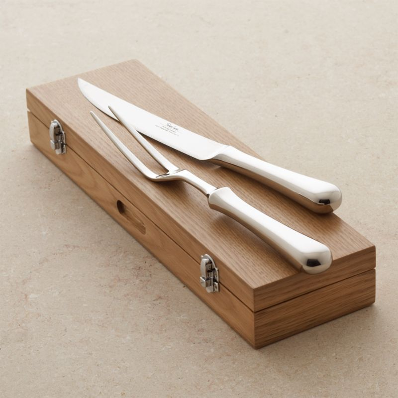 Classically designed carving set with attractive, bright mirror finish compliments any table setting. Knife and long-tined fork are well balanced and comfortable in hand and come packaged in a handsome wood storage box.<br /><br /><NEWTAG/><ul><li>18/10 stainless steel</li><li>Forged</li><li>Wood storage box</li><li>Dishwasher-safe</li><li>Made in Taiwan</li></ul>