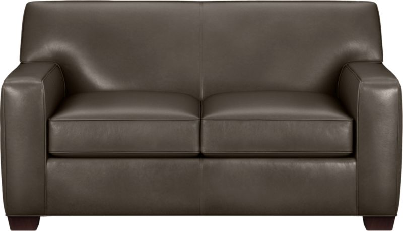 The classic modern leather loveseat we've all been looking for in the richest, most supple leather there is—clean-lined but not too edgy, graceful but never fussy. Top-grain Italian hide is aniline-dyed and hand-stained to a handsome tonal effect that only gets more lustrous with time. Natural pebble grain is beautifully showcased by impeccable tailoring with self-welt detail. Wide track arms frame plush, generous seat cushions that sink deep into a comfortably angled tight back. Hardwood legs are stained black walnut.<br /><br />After you place your order, we will send a leather swatch via next day air for your final approval. We will contact you to verify both your receipt and approval of the leather swatch before finalizing your order.<br /><br /><NEWTAG/><ul><li>Eco-friendly construction</li><li>Certified sustainable kiln-dried hardwood frame</li><li>Seat cushions are soy-based polyfoam wrapped in regenerated synthetic fiber and encased in downproof ticking</li><li>Tight back is filled with soy-based polyfoam and regenerated synthetic fibers</li><li>Sinuous wire spring suspension</li><li>Upholstered in aniline-dyed leather with self-welt detailing</li><li>Benchmade</li><li>See additional frame options below</li></ul>