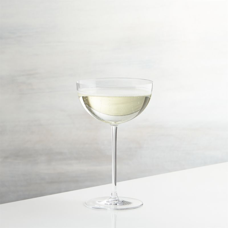 Gatsby-era glamour in this statuesque take on the classic champagne coupe, still the connoisseur's choice for sweeter sparkling wines. Handmade glass puts its saucer-shaped bowl on a slim stem to showcase champagne, prosecco, colorful cocktails or even a dessert.<br /><br /><NEWTAG/><ul><li>Handcrafted</li><li>Glass</li><li>Fire-polished rim</li><li>Hand washing recommended, cradle bowl when cleaning</li><li>Made in Slovakia</li></ul>