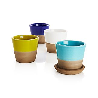 Two-tone earthenware planters cache small pots of herbs or small flowers in garden-party brights with contrasting neutrals. Add the optional saucer to set the perfect foundation for our two-tone Carnivale planters.Glazed earthenwareFor indoor or outdoor useDrainage holeBring indoors during freezing temperaturesHand washMade in Portugal