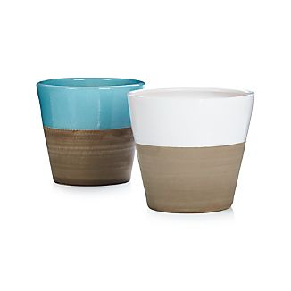 Two-tone terra cotta planters cache potted flowers or herbs in garden-party brights contrasted with the natural look of neutral clay. Add the optional saucer to set the perfect foundation for our two-tone Carnivale planters.Glazed earthenwareFor indoor or outdoor useDrainage holeFor indoor or outdoor useBring indoors during freezing temperaturesMade in Portugal