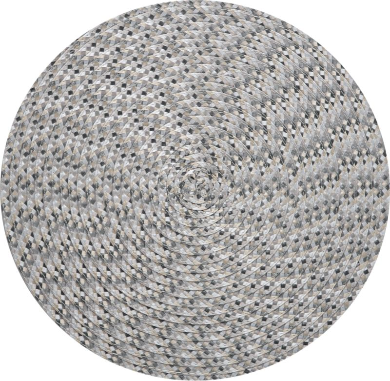 A small check of woven neutrals is embroidered in concentric circles creating a vibrant optic pinwheel.  Modern round mat is easy-care polypropylene.<br /><br /><NEWTAG/><ul><li>Embroidered polypropylene</li><li>Clean with a damp cloth</li><li>Made in China</li></ul>