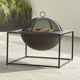 This smaller version of the Carswell firepit sports the same architectural design, suspending a round bowl from an open, square frame, all with a smart black, heat-resistant finish. A mesh lid keeps sparks contained, and the bowl's interior is hammered to minimize the look of log dents over time. Removable grate and stand make for easy cleaning.