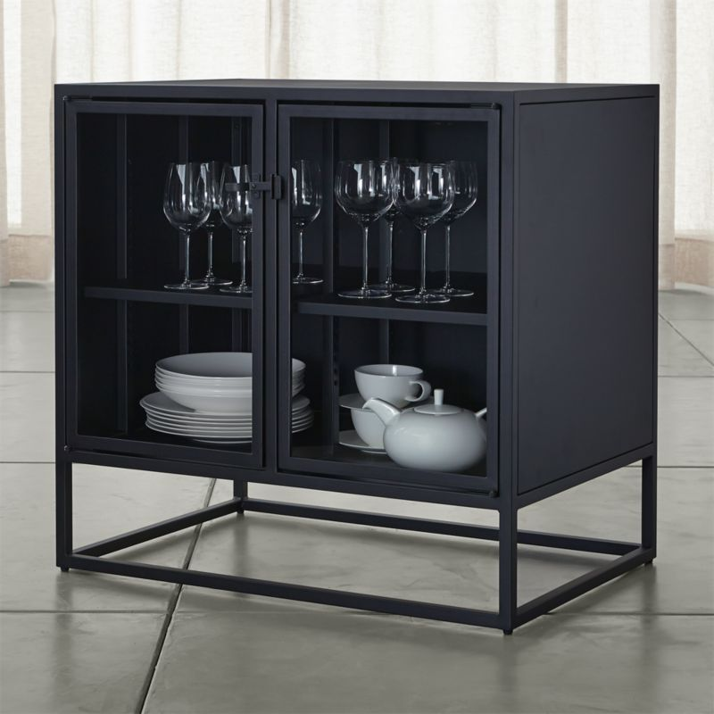 Designed by Paul Schulman of Schulman Design, Casement takes inspiration from the clean lines of vintage French casement windows. With a black steel frame latched with simple industrial hardware, small sideboard's narrow silhouette allows for maximum storage behind clear glass doors. <NEWTAG/><ul><li>Designed by Paul Schulman of Schulman Design</li><li>Steel with powdercoat finish</li><li>2 glass front doors</li><li>2 adjustable metal shelves</li><li>4 levelers on base</li><li>Made in China</li></ul>