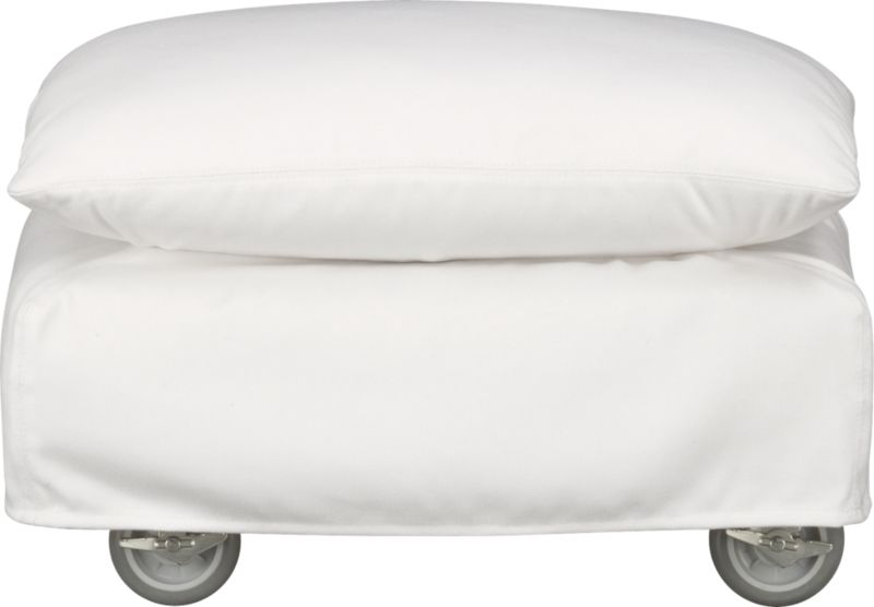 This sleek white slipcovered ottoman looks like it could be right at home in a modern urban loft. But don't bother to come inside—our eco-friendly Catalina collection is designed to live carefree outdoors under blue skies. Under that UV-, fade- and moisture-resistant Sunbrella® sailcloth slipcover (yes, it's even machine-washable), you'll find a thoughtfully crafted chair with a 15-ply outdoor-grade sustainable birch plywood frame made in the USA at the same furniture workshop as many of our living room upholstered collections. Plush cushion is a reticulated open-cell foam that allows water to drain. Upholstered in Sunbrella base cloth sand, an open-weave fabric that accelerates drainage and allows cushion to breath, with a bottom zipper to drain water and release moisture. Four rust-resistant galvanized steel casters allow for effortless seating rearrangements or for moving indoors out of season.<br /><br />After you place your order, we will send a fabric swatch via next day air for your final approval. We will contact you to verify both your receipt and approval of the fabric swatch before finalizing your order.<br /><br /><NEWTAG/><ul><li>Eco-friendly construction</li><li>Outdoor-grade sustainable birch plywood frame</li><li>Cushion is mildew-resistant, reticulated open-cell foam</li><li>Slipcovered in 100% Sunbrella solution-dyed acrylic</li><li>Machine wash the removable slipcovers; line dry</li><li>Four rust-resistant galvanized steel casters (two lock)</li><li>See additional frame options below</li></ul>