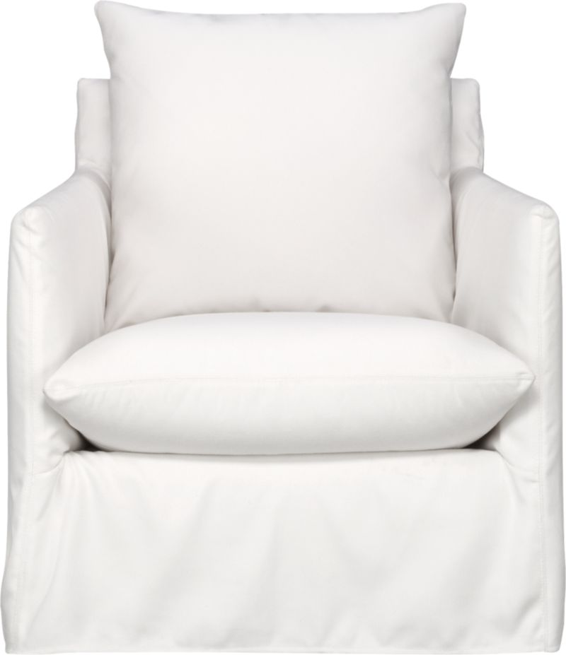 This sleek white slipcovered chair looks like it could be right at home in a modern urban loft. But don't bother to come inside—our eco-friendly Catalina collection is designed to live carefree outdoors under blue skies. Under that UV-, fade- and moisture-resistant Sunbrella® sailcloth slipcover (yes, it's even machine-washable), you'll find a thoughtfully crafted chair made in the USA at the same furniture workshop as many of our living room upholstered collections. A 15-ply outdoor-grade sustainable birch plywood frame subtly slopes the seat deck front to back to drain water properly from an open bottom slot. Plush cushions are a reticulated open-cell foam that allows water to drain. Comfortable back cushion is protected by waterproof ticking. Upholstered in Sunbrella base cloth sand, an open-weave fabric that accelerates drainage and allows cushions and pillows to breath, with a bottom zipper to drain water and release moisture. Swivel action rotates 360 degrees.<br /><br />After you place your order, we will send a fabric swatch via next day air for your final approval. We will contact you to verify both your receipt and approval of the fabric swatch before finalizing your order.<br /><br /><NEWTAG/><ul><li>Eco-friendly construction</li><li>Outdoor-grade sustainable birch plywood frame</li><li>Seat cushion is are mildew-resistant, reticulated open-cell foam</li><li>Back cushion is filled with outdoor recycled fiber in a waterproof ticking</li><li>Slipcovered in 100% Sunbrella solution-dyed acrylic</li><li>