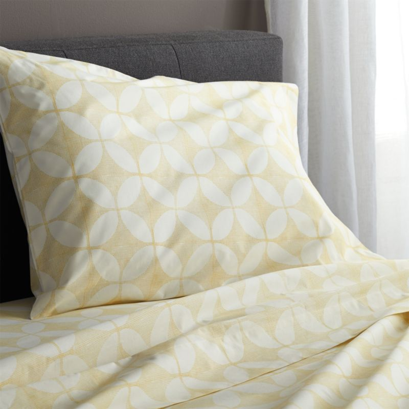 Taking note of the stunning textiles of India's Rajasthan region, the Cate collection recreates the artisanal play of organic and geometric forms in vibrant color. Versatile look in soft, cotton percale mixes and matches for a varied, layered bed. Generous fitted sheet pockets accommodate thicker mattresses. Set includes one flat sheet, one fitted sheet and one standard pillow case. Bed pillows also available.<br /><br /><NEWTAG/><ul><li>100% cotton percale</li><li>200-thread-count</li><li>Machine wash cold; tumble dry low; warm iron as needed</li><li>Do not bleach</li><li>Made in India</li></ul>
