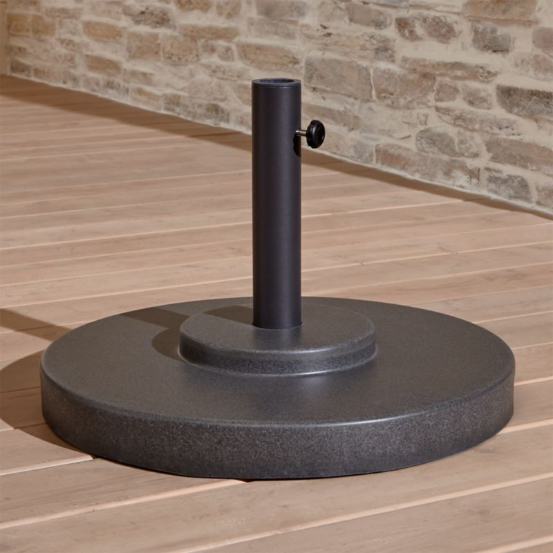 "Scaled-up charcoal grey umbrella stand with rugged construction in carefree rustproof fiberstone anchors your outdoor umbrella, with or without a table. We recommend the large stand for freestanding use.<br /><br /><NEWTAG/><ul><li>Rustproof poly resin and stone mixture in charcoal and black finish</li><li>Cutout handle for easy lifting</li><li>Use large stand with any of our umbrella frames: accommodates 1.5"" dia. pole with adapter, or 1.875"" dia. pole without adapter</li><li>Large stand works with a table or on its own</li><li>Assembly required to thread cylinder and feet to base</li><li>Made in China</li></ul>"