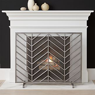 Bold chevrons lend a mid-century look to Ana Reza-Hadden's clean, graphic fireplace screen. Each screen is handmade by welding multiple iron wires together and adding a final coat of antique pewter finish.