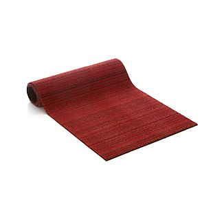 Durable, all-weather PVC and polyester are textured and looped in tonal bands of reds and neutrals. Equally at home indoors and out, this oversized doormat is finished with vinyl backing.View all Chilewich products