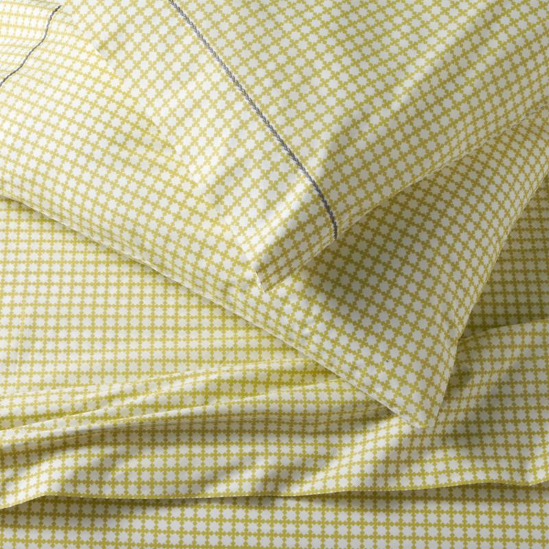 Evocative of bamboo screens, soft focus grid of four-leaf forms is screen-printed on soft cotton percale for an understated look that coordinates well with prints and solids. Pillowcases are embellished with single row of hand-embroidered chain stitching in contrasting blue. Sheet set includes one flat sheet, one fitted sheet and two king pillowcases. Bed pillows also available.<br /><br /><NEWTAG/><ul><li>100% cotton percale</li><li>200-thread-count</li><li>Machine wash cold, tumble dry low; warm iron as needed</li><li>Made in India</li></ul>
