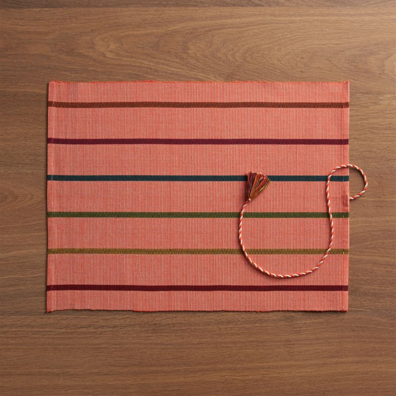 Subtle weave lends softness to hand-dyed neutrals and brights in this fun, casual placemat. Tasseled tie adds a folkloric note as well as serving as a tie when the mat is rolled up for storage.<br /><br /><NEWTAG/><ul><li>Handcrafted</li><li>100% cotton</li><li>Machine wash cold, dry flat; hot iron as needed</li><li>Oversized to allow for shrinkage</li><li>Made in India</li></ul>