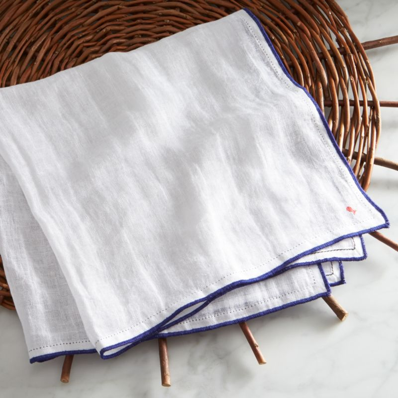 Paolo Navone's Como collection is inspired by her world experiences and life, infusing each piece with coastal color and attitude. Light as a shore breeze, gauzy linen napkins are generously scaled and finished with stitched edging and blue-serge hems, each marked with a tiny fish, the designer's signature logo.<br /><br /><NEWTAG/><ul><li>Designed by Paola Navone exclusively for Crate and Barrel</li><li>100% gauze linen</li><li>Machine wash gentle cycle, dry flat; warm iron as needed</li><li>Made in India</li></ul>