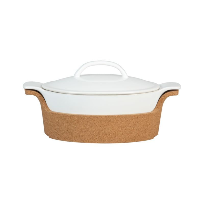 In an innovative mix of functional materials, our exclusive stoneware baker nests in a renewable cork carrier that doubles as trivet. With a size based on standard recipes, all-purpose baker is perfect for passing hot dishes and setting them right on the table. Baker and carrier can also be used separately.<br /><br /><NEWTAG/><ul><li>Stoneware and cork</li><li>Bakeware is dishwasher-, microwave-, freezer- and oven-safe to 400 degrees</li><li>Made in Portugal</li></ul><br />