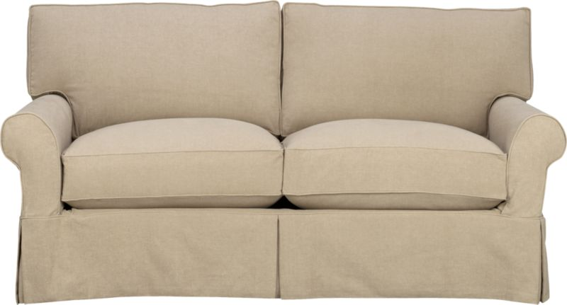 """A Crate and Barrel classic with a relaxed attitude and overstuffed appeal. Easy comfort and quality construction feature deep cushions and plump rolled arms. Prewashed cotton slipcovers with self-welt detail and dressmaker skirt are machine-washable.<br /><br />Additional <a href=""""http://crateandbarrel.custhelp.com/cgi-bin/crateandbarrel.cfg/php/enduser/crate_answer.php?popup=-1&p_faqid=125&p_sid=DMUxFvPi"""">slipcovers</a> available below and through stores featuring our Furniture Collection.<br /><br />After you place your order, we will send a fabric swatch via next day air for your final approval. We will contact you to verify both your receipt and approval of the fabric swatch before finalizing your order.<br /><br /><NEWTAG/><ul><li>Eco-friendly construction</li><li>Certified sustainable, kiln-dried hardwood frame</li><li>Seat cushions are multilayer soy- or plant-based polyfoam wrapped in down blend and encased in downproof ticking</li><li>Back cushions are synthetic fiber and feather-down blend wrapped in downproof ticking</li><li>Flexolator spring suspension</li><li>100% prewashed cotton slipcover</li><li>Removable slipcovers are machine washable</li><li>Benchmade</li><li>See additional frame options below</li></ul>"""
